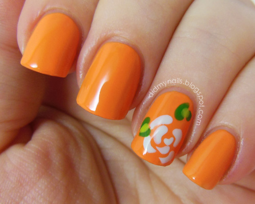 Orange Accent And White Flower Nail Art