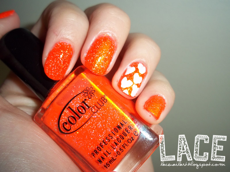 Orange Accent Nails With White Heart Nail Art