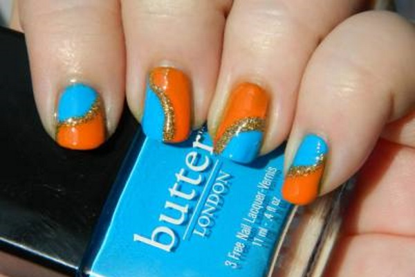 Orange And Blue Nails With Gold Glitter Strip Design
