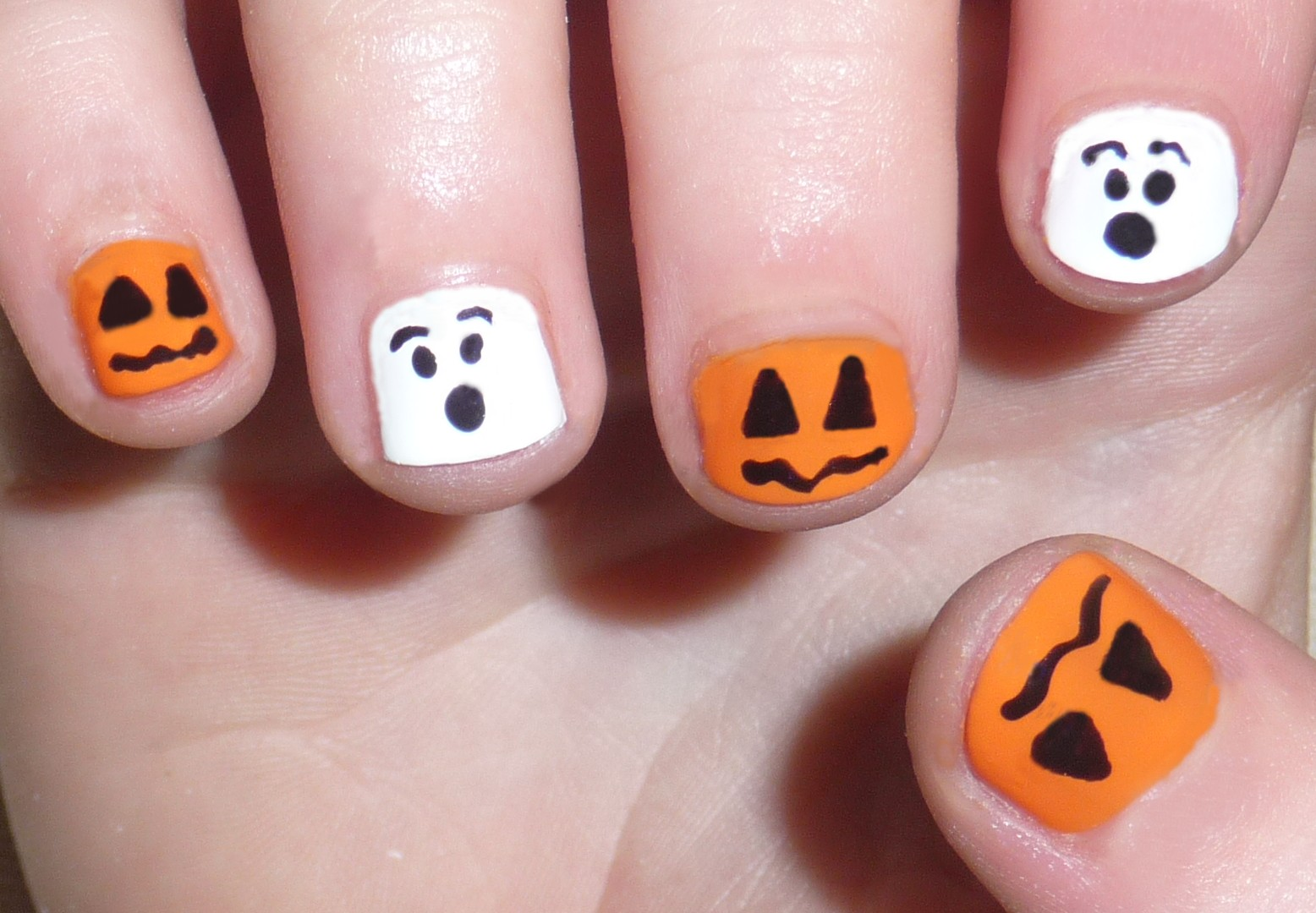 Orange And White Halloween Scary Faces Nail Art For Short Nails