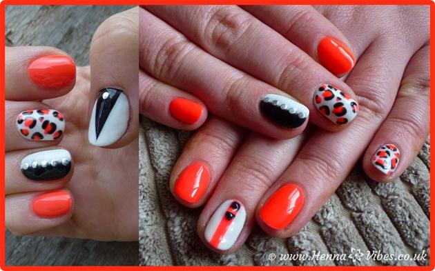 Orange And White Leopard Print Nail Art