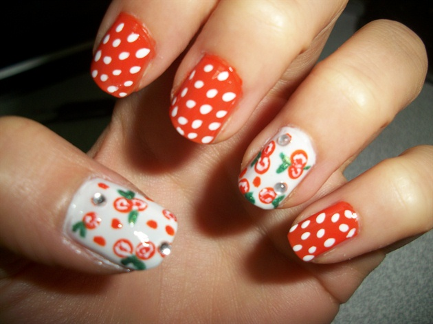 Orange And White Polka Dots With Flowers Design Nail Art