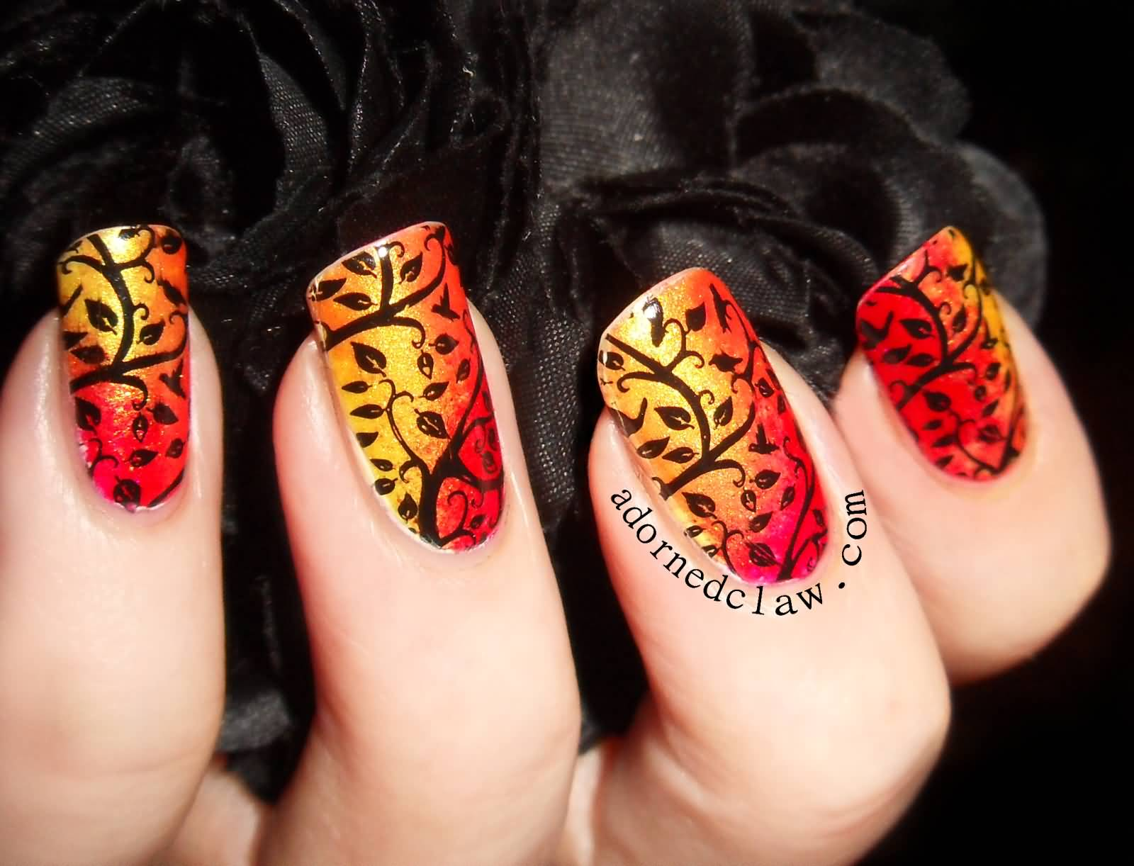 Orange And Yellow Gradient Nails With Black Autumn Leaves Nail Art Design Idea