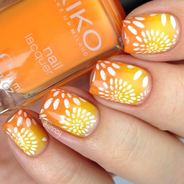 Orange And Yellow Gradient Nails With White Flowers Nail Art
