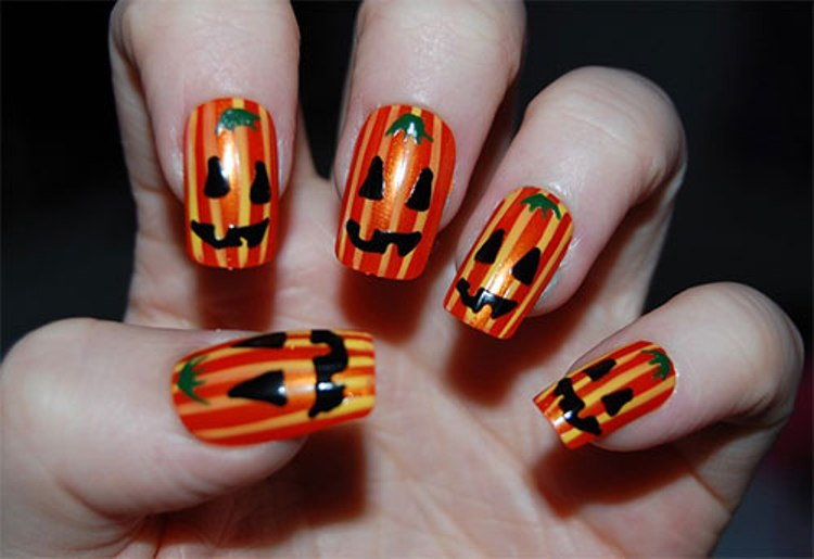 Orange And Yellow Stripes Pumpkin Faces Nail Art