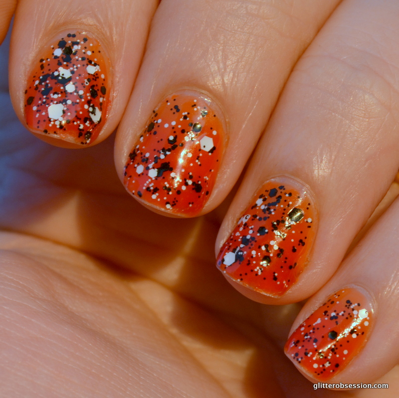 Orange Base Nails With Black And White Color Splatter Nail Art