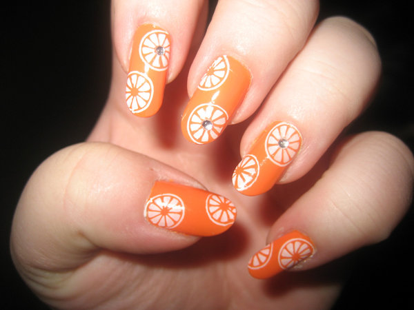 Orange Base Nails With White Flowers And Rhinestones Design Nail Art