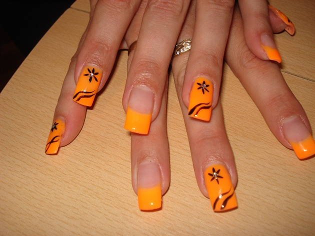 Orange French Tip With Black Flowers Nail Art