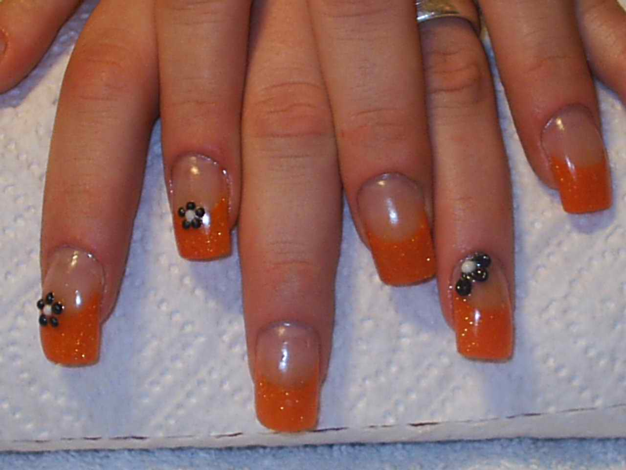 Orange Glitter Gel Tip With Black Caviar Beads Floral Design Nail Art