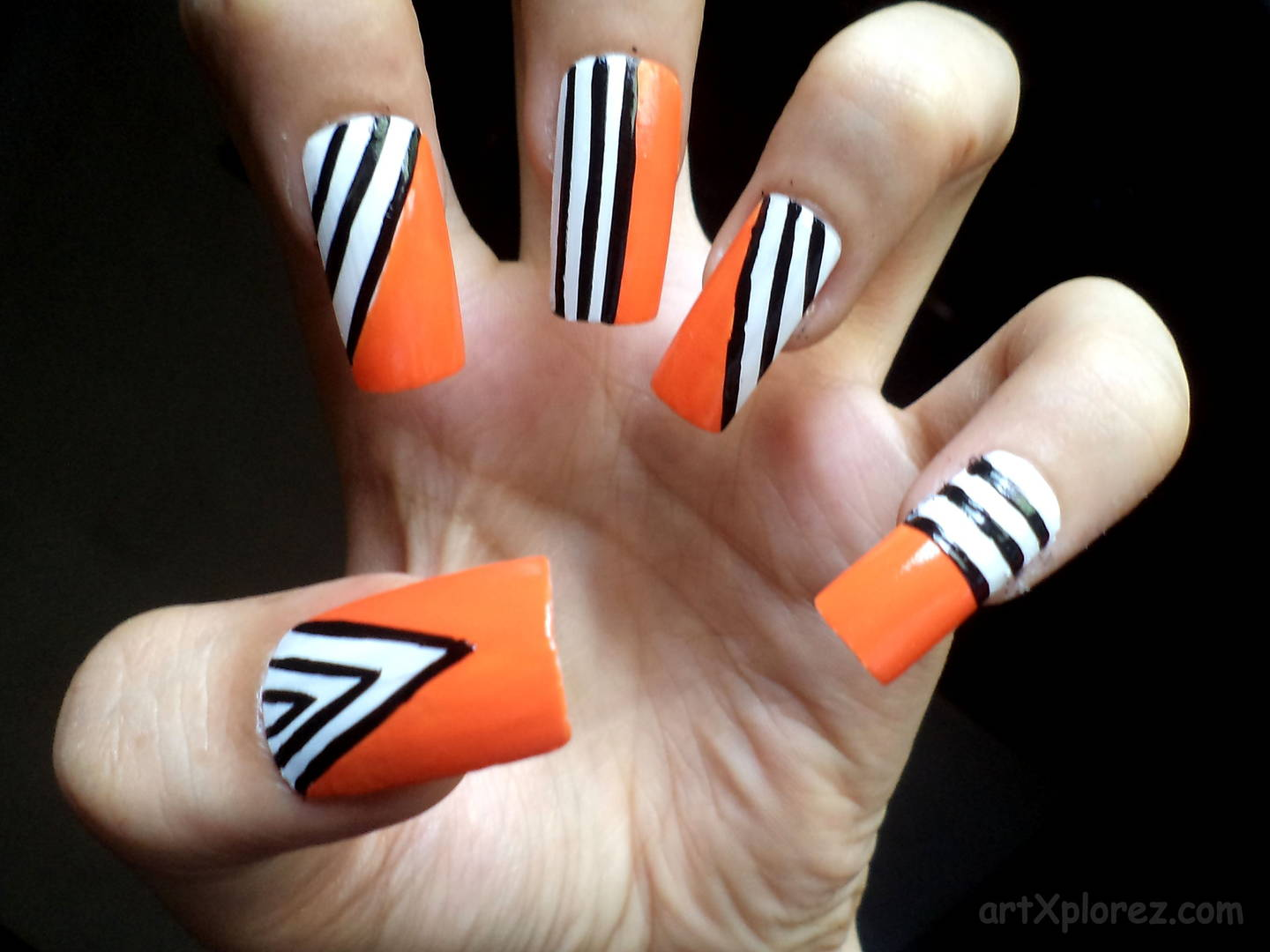 Orange Nails With Black And White Duo Stripes Design Nail Art