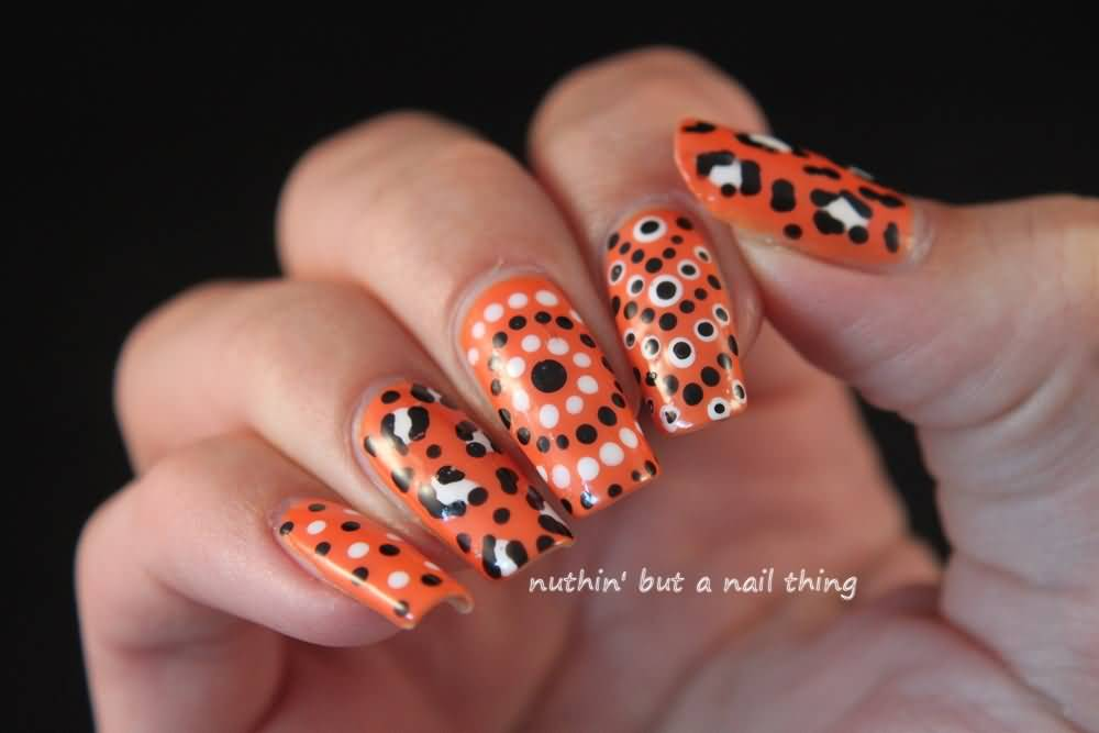 Orange Nails With Black And White Polka Dots And Leopard Print Nail Art