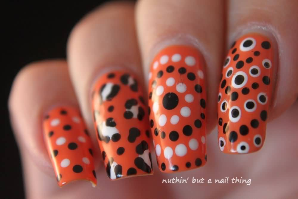 Orange Nails With Black And White Polka Dots Nail Art