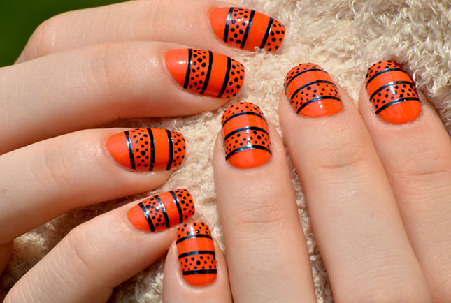 - Orange Nails With Black Dots And Stripes Nail Art Design