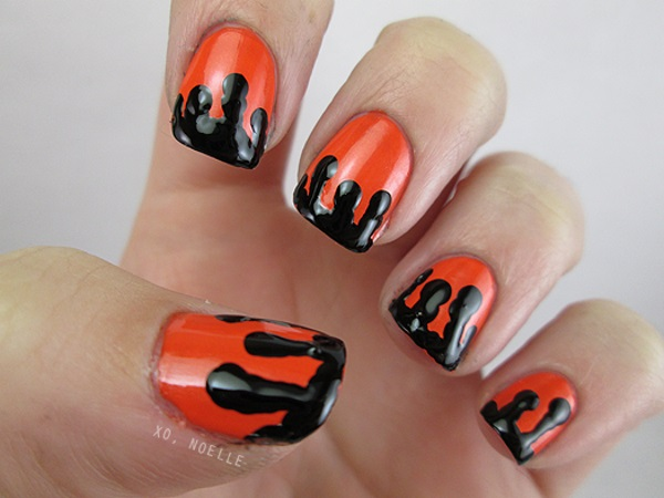 Orange Nails With Black Melted Design Nail Art - 60 Stylish Orange Nail Art Designs