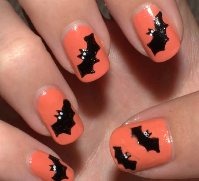 Orange Nails With Black Silhouette Bats Design Nail Art