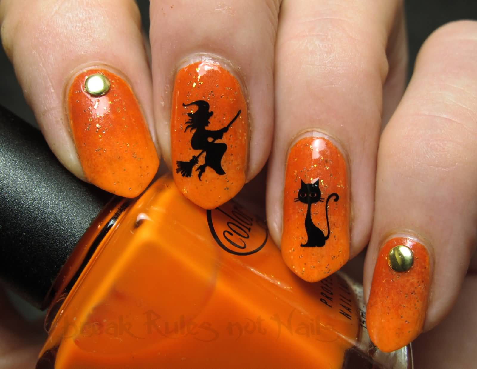 Orange Nails With Black Silhouette Cat And Witch Nail Art