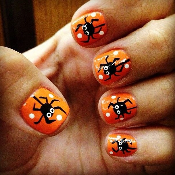 Orange Nails With Black Spiders Nail Art