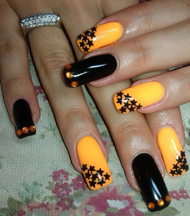 Orange Nails With Black Stars Design Idea