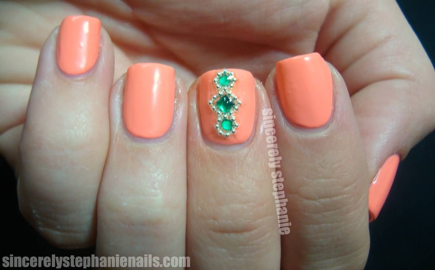 Orange Nails With Green Rhinestones Accent Nail Art