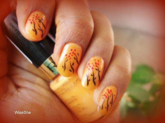 Orange Nails With Pink Floral Design Nail Art