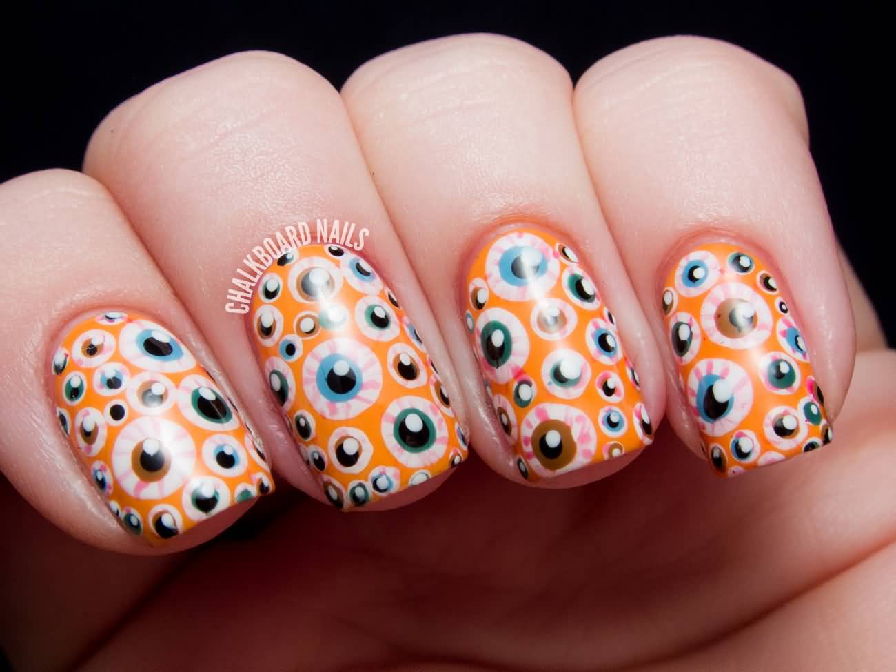 Orange Nails With Scary Eyes Halloween Nail Art