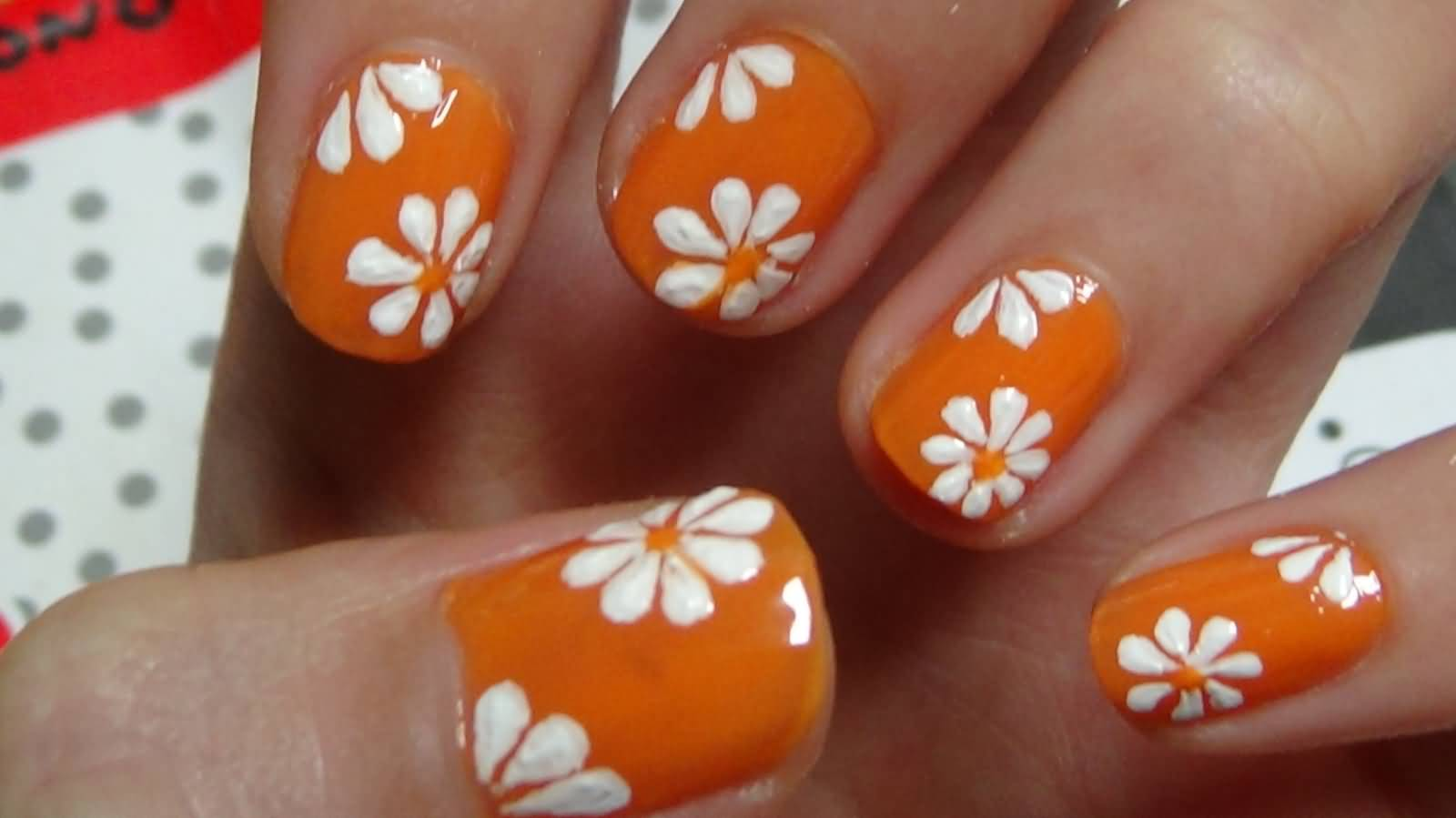 Orange Nails With White Acrylic Flowers Design Nail Art