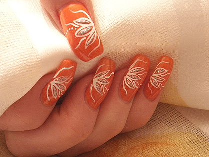 Orange Nails With White Flower Design Nail Art