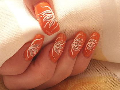 Orange Nails With White Flower Design Nail Art