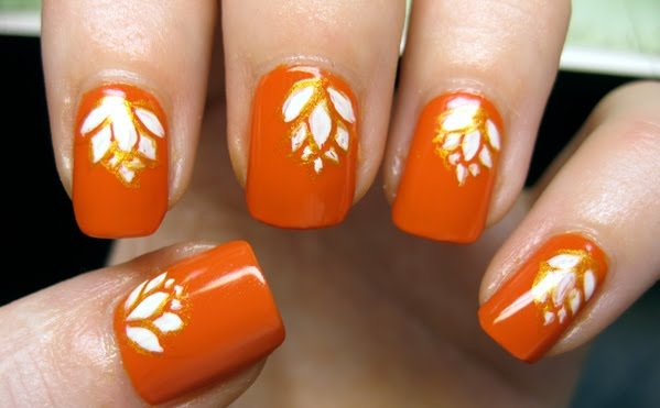 Orange Nails With White Flowers Nail Art