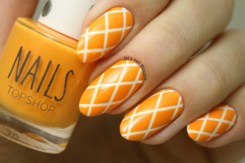 Orange Nails With White Geometric Lines Design Nail Art