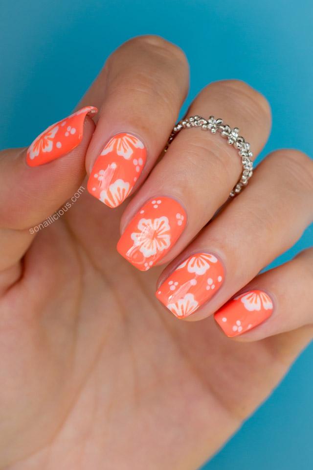 Orange Nails With White Hawaiian Flowers Nail Art