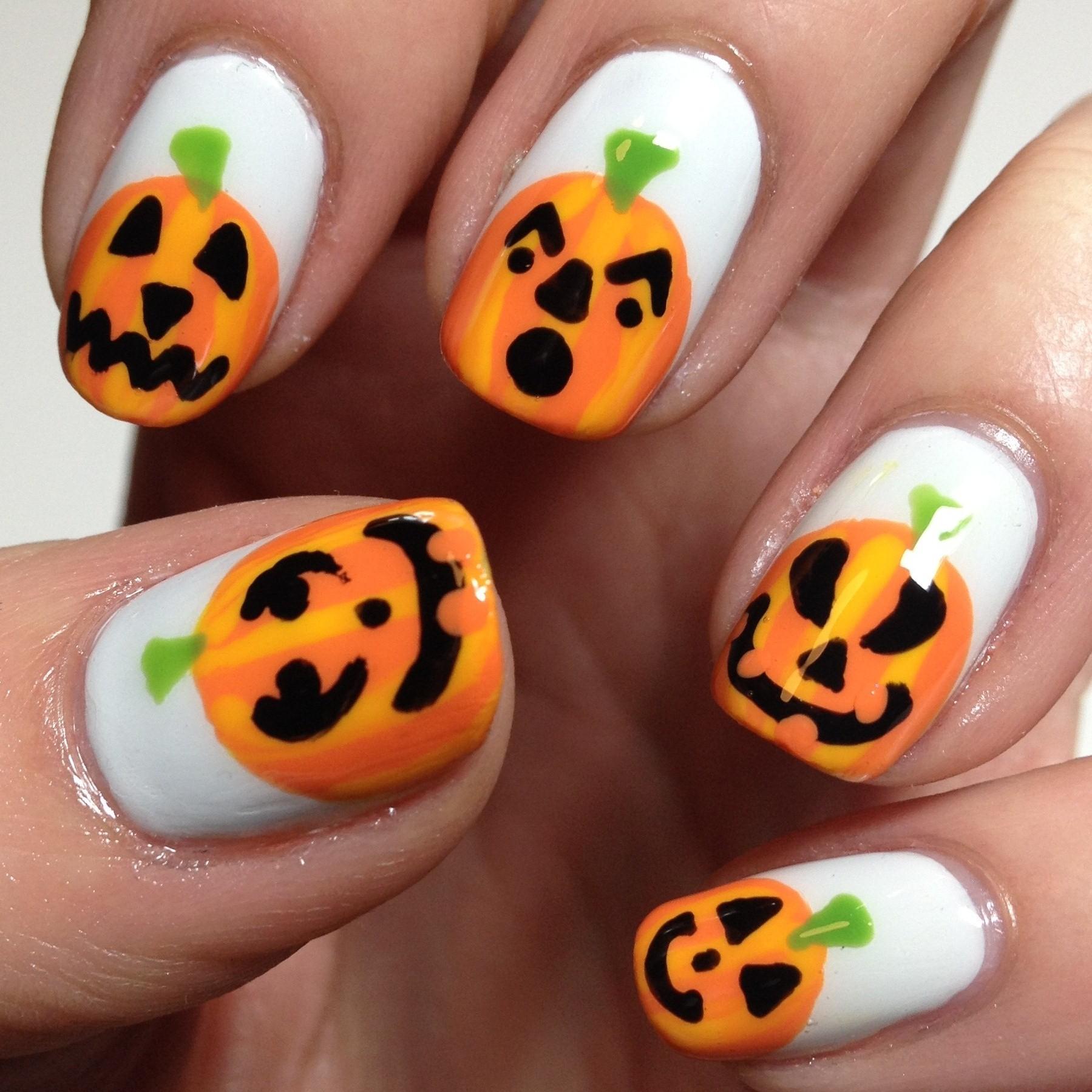 Orange Pumpkins On White Nails Design