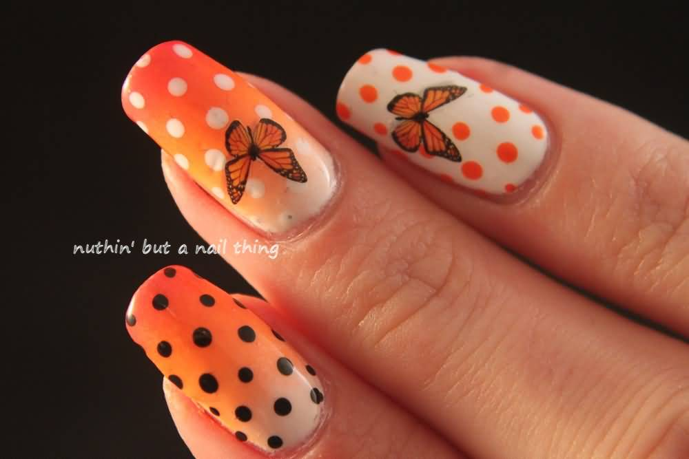 Orange White And Black Polka Dots And Butterfly Nail Art