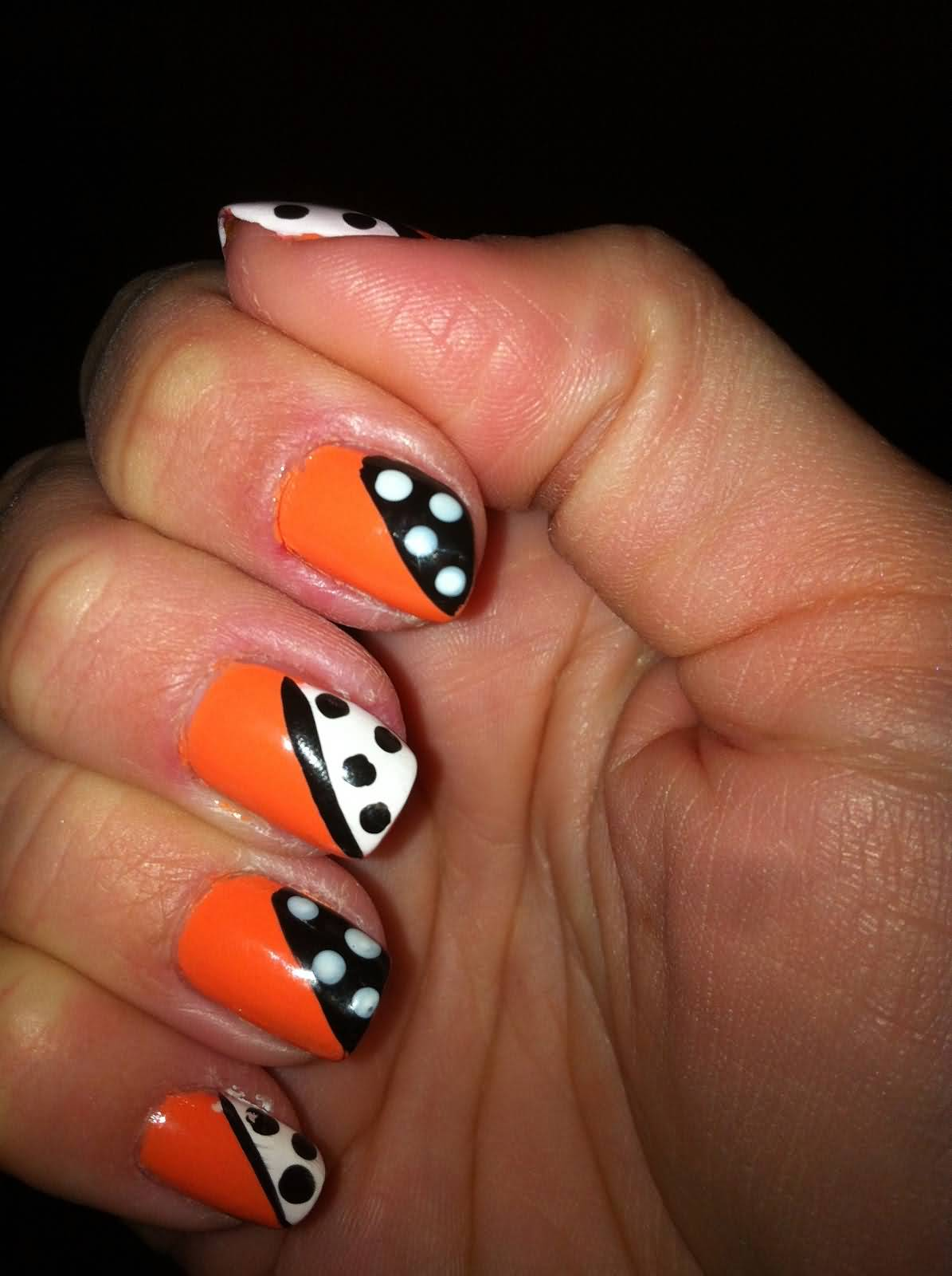 Orange With Black And White Diagonal Polka Dots Nail Art Design Idea