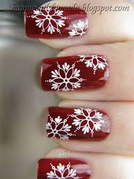 red nails with white snowflakes design christmas nail art