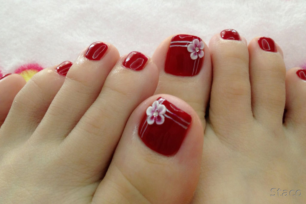 red toe nails with 3d flower design