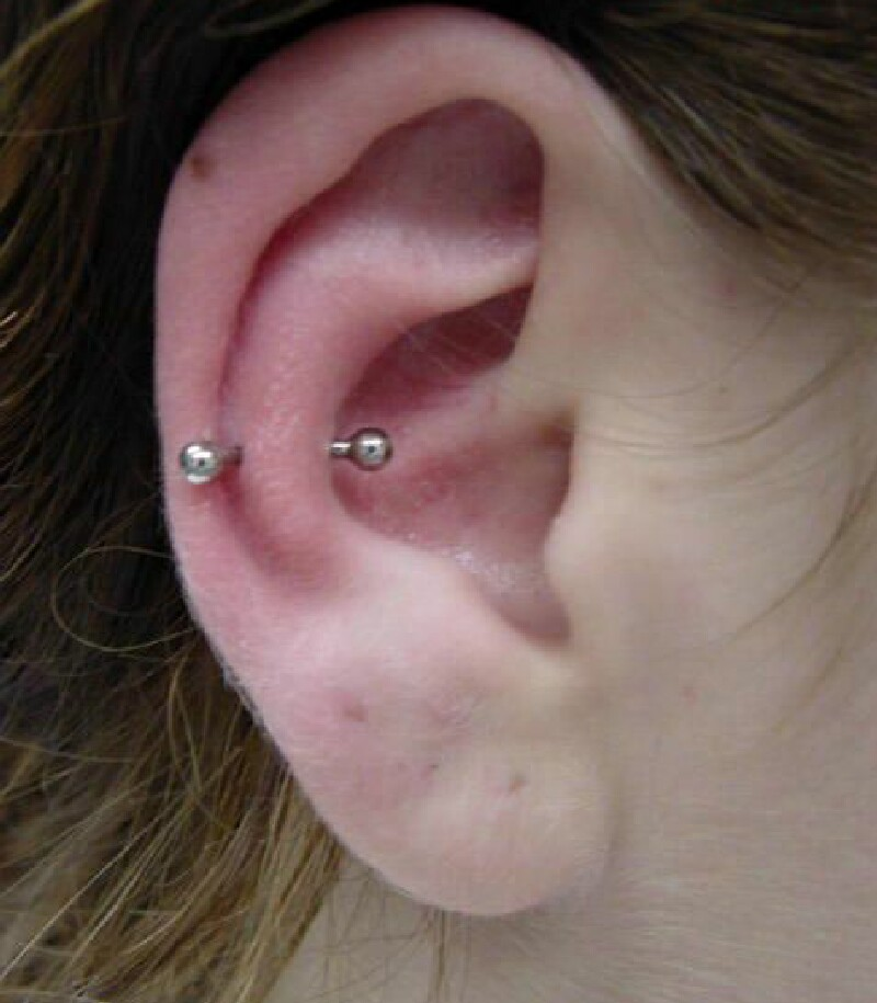 snug piercing with silver barbell