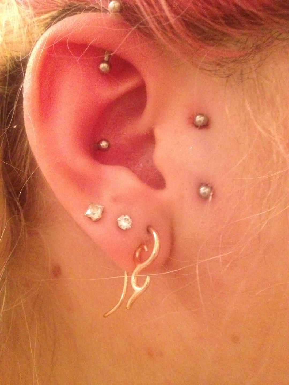 Triple Ear Lobe And Surface Ear Piercing On Girl Right Ear