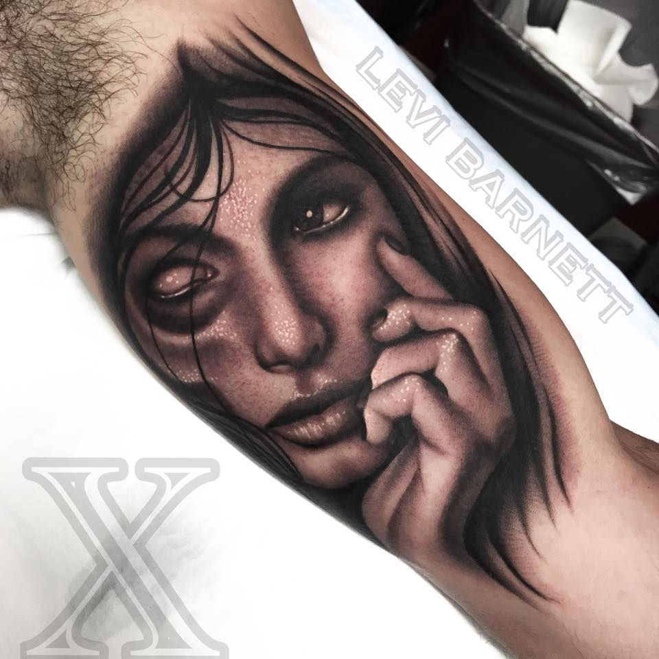 fa9ea5944 Vampire girl tattoo on bicep by Levi Barnett