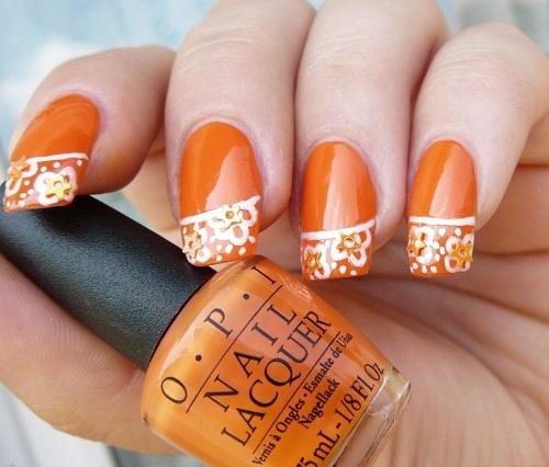 White Floral On Orange Nails