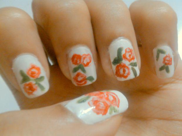 White Nails And Orange Flower Nail Art