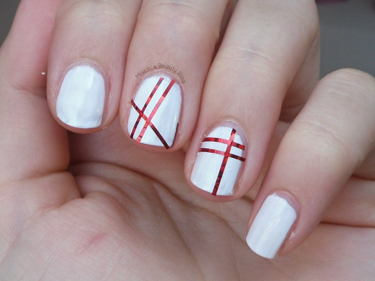 White Nails And Red Striping Tape Nail Art