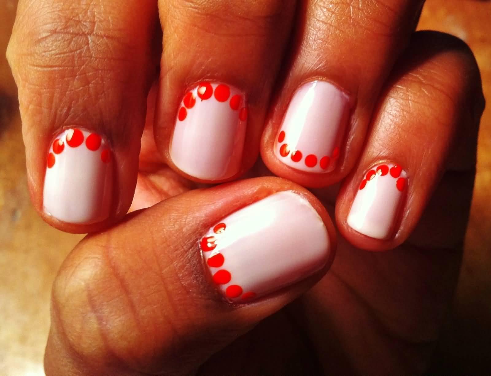 White Nails With Orange Polka Dots Nail Art