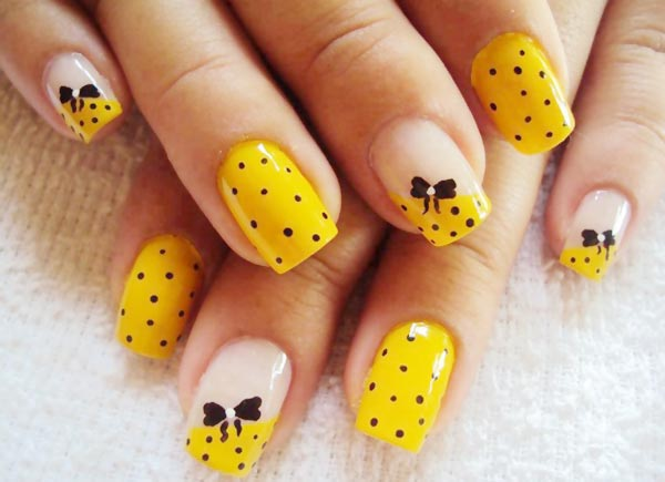 Yellow And Black Dots With Bow Design Nail Art