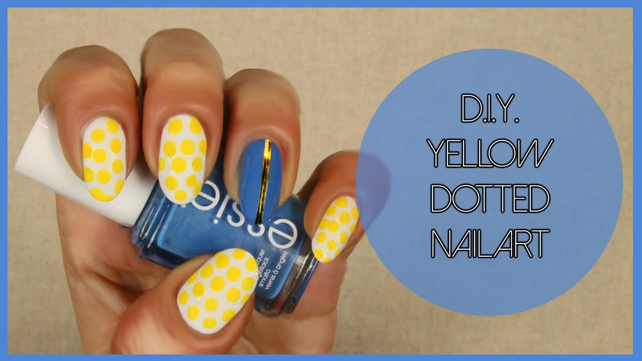 Yellow Dotted And Accent Blue Nail Art