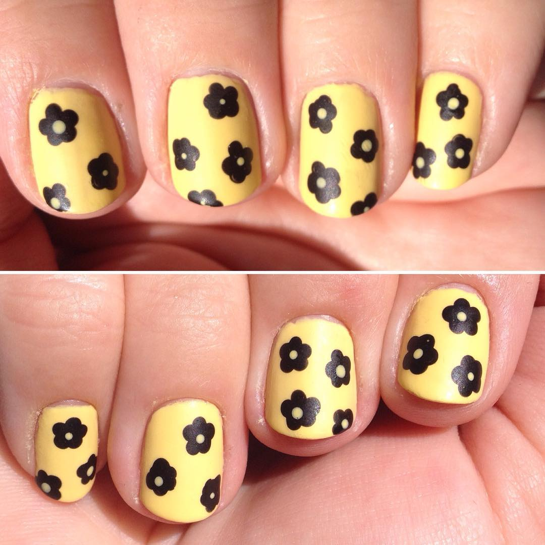Yellow Nails And Black Flower Nail Art