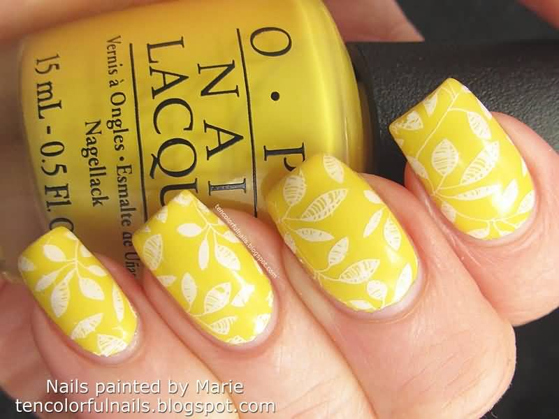 Yellow Nails And White Stamped Flowers Nail Art Design