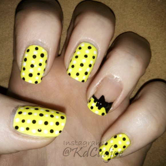Yellow Nails With Black And White Polka Dots And 3D Bow Design Idea