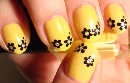Yellow Nails With Black Flowers Tip Design Idea
