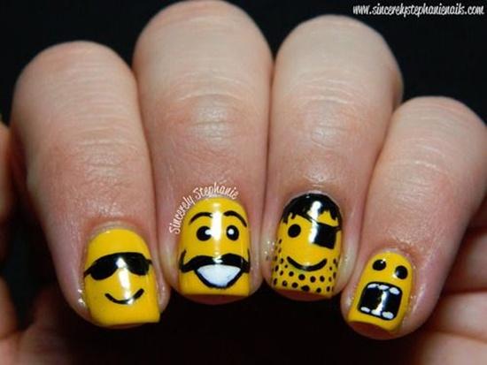 Yellow Nails With Faces Nail Art